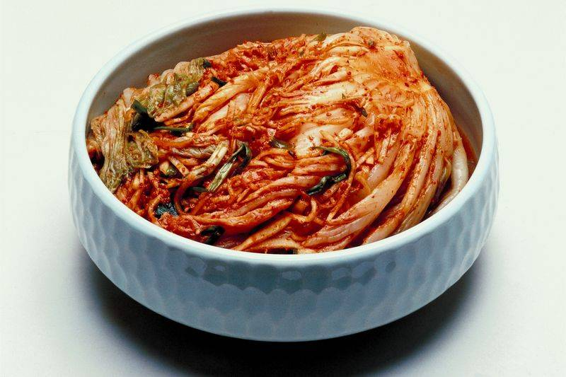 Bowl of kimchi, Part 5 on Fermentation: Kimchi vs. Sauerkraut - Fermenting Vegetables, by Diana Zahuranec for The Rambling Epicure, editor, Jonell Galloway.