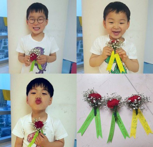 Song Il-gook takes shots of the triplets holding carnations
