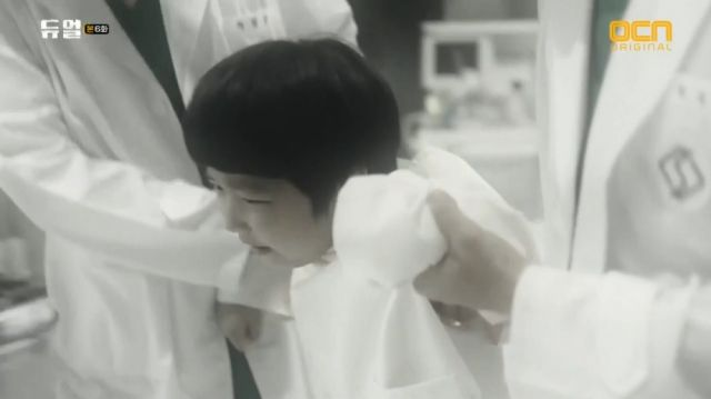 A young Seong-hoon being dragged to experiments