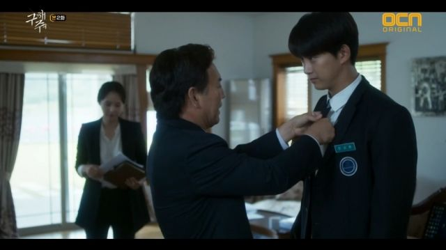 Sang-hwan and his father asking him to not get in trouble