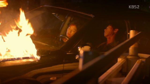 Mi-ran and Min-joon in a burning vehicle